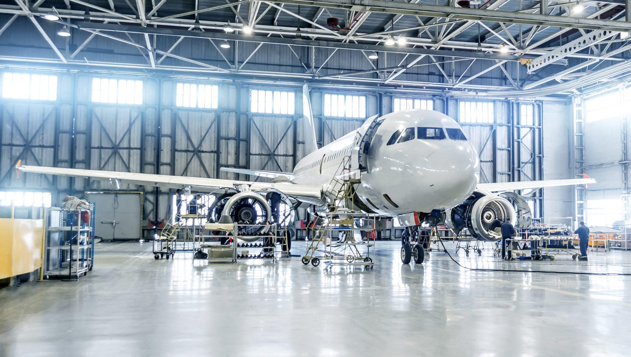 Passenger airplane on maintenance of engine and fuselage check repair in airport hangar